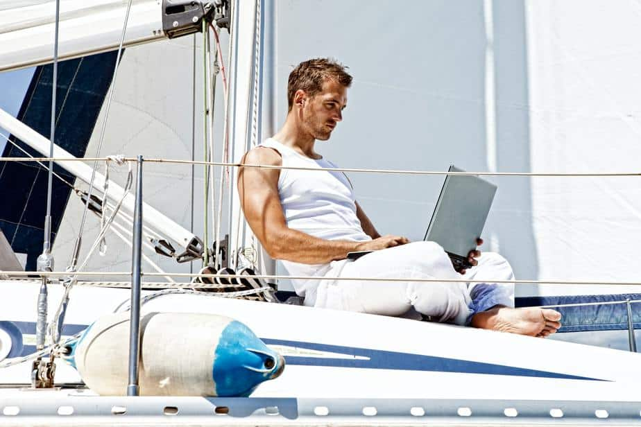 A digital nomad working on a yacht