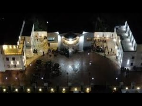 E-Money's Mansion outside view at night