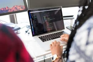 A woman performing the job of a software developer, one of the top future careers worth looking into
